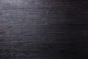 Burned black wooden background