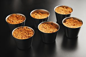 Apple crumble dessert in small steel pans