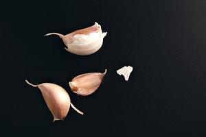 Garlic cloves on black