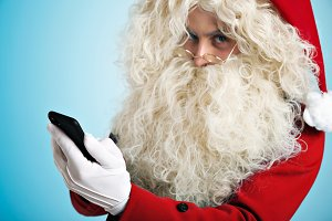 Santa with gadgets in hands