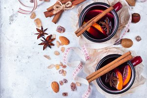 Hot mulled wine in a red mug for winter holidays