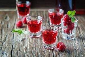Red cocktail with raspberry and mint