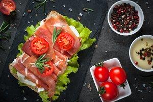 Ciabatta sandwich with  salad leaves jamon serrano mozzarella