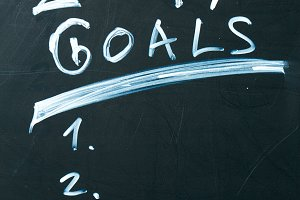 inscription 2017 goals it list drawn with chalk on a school blackboard dark