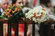 Bouquets of orange and white roses
