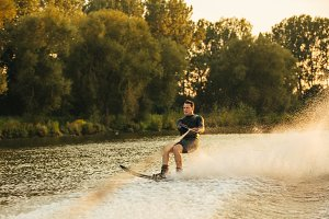 Man water skiing on lake