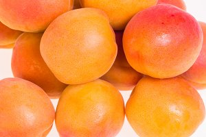 Apricots close up on white