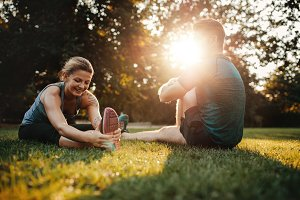 Couple doing stretching exercises
