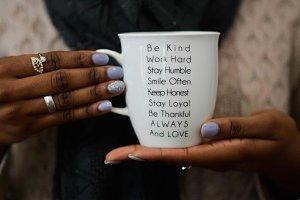 African Woman Holding Mug