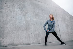 Young sports woman exercising