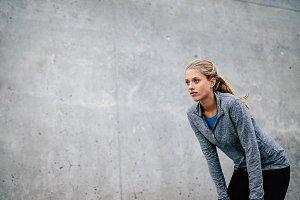 Young sports woman taking break