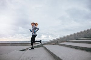 Healthy young woman running
