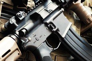 Tactical M4A1 (AR-15) carbine on bulletproof vest