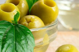 Green pickled pitted olives