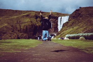Pretty woman jumping Iceland