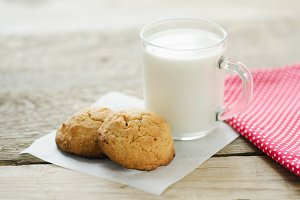 cup of milk with oatmeal cookies
