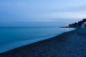 night pebbly beach and sea