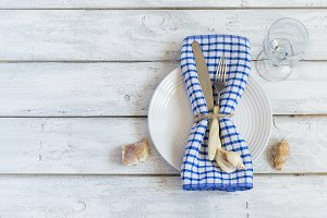 Summer marine style table setting, top view, space for text
