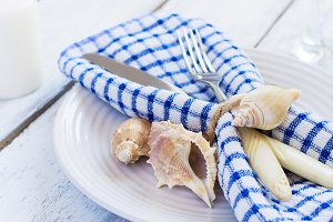 Summer table setting in marine style, decorated with shells