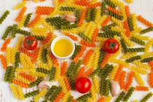 Green, orange and yellow Fusilli pasta background