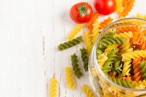 colorful italian fusilli pasta in a jar, selective focus, space