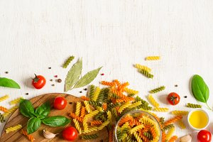 Overhead Italian colored pasta  background
