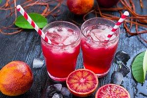 Juice of blood orange on a dark background