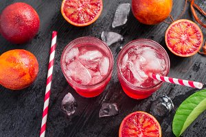 Two glasses of juice of blood oranges, top view
