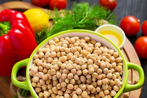 chickpeas and bright vegetables and vegetable oil, selective foc