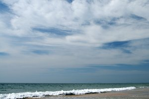 the sea beach and cloudy blue sky