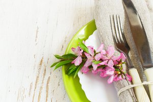 Spring table setting closeup, Decorated branch of flowering almo