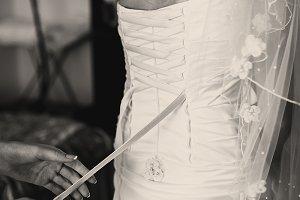 Woman lace up a corset