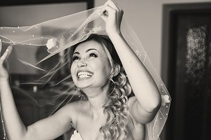 Bride laughs sincerely