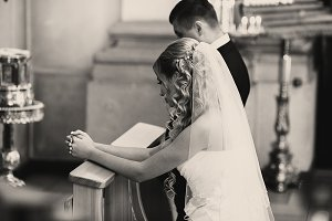 Bride and groom pray