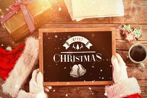 Santa claus holding a slate