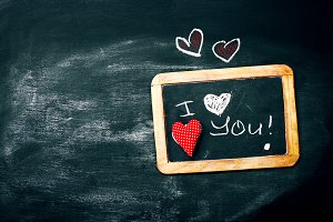 Love concept with chalkboard, heart