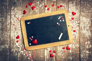 Love concept with chalkboard,hearts