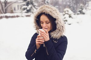 Woman drinking her hot beverage tea