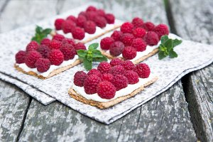 canapes with cheese and raspberries