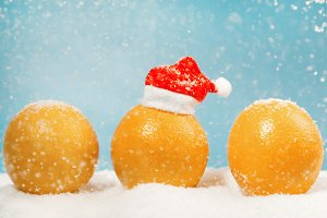 Three Christmas oranges