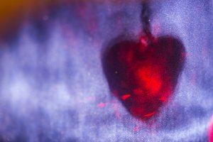 Red heart shape shadow on blue surface, abstract holiday background