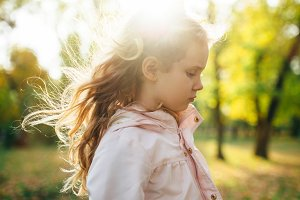 Autumn portrait of cute blonde girl