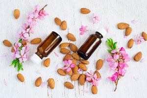 Spring Spa background with almond essential oil and flowers