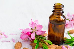 Almond essential oil, flowers and nuts