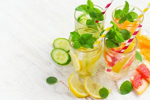 Summer drinks water with ice, mint and citrus, copy space