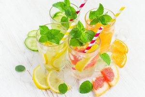Summer drinks with ice, mint and citrus. Infused water in glass