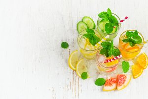 Summer drinks water with ice, mint and citrus, copy space.