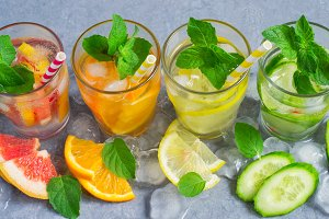 Refreshing Detox summer drinks water with ice and citrus and cuc