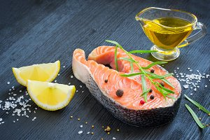 Steak of fresh salmon with aromatic herbs and spices. healthy fo