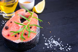 Steak of fresh salmon with aromatic herbs and spices. copy space